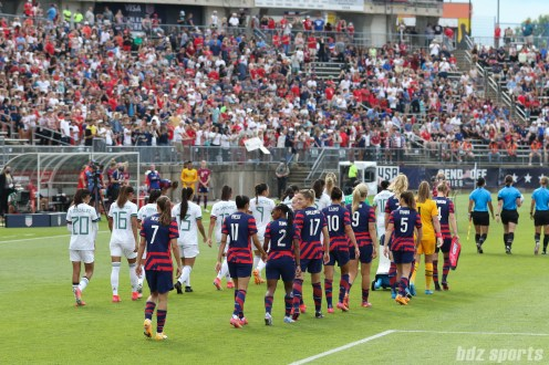 The starting eleven walk on to the pitch in the second of two 2021 WNT Send-Off Series games between the USWNT and Mexico at Rentschler Field in East Hartford, CT on July 5, 2021.