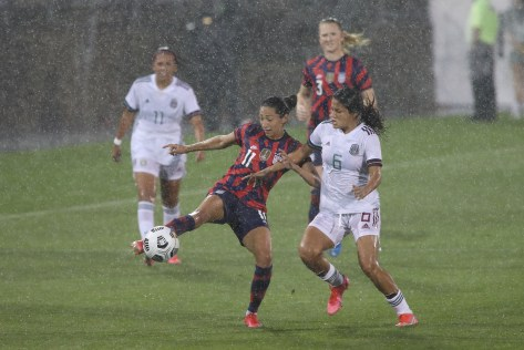 USWNT forward Christen Press (11) and Team Mexico midfielder Rebeca Bernal (6) in the first of two 2021 WNT Send-Off Series games between the USWNT and Mexico at Rentschler Field in East Hartford, CT on July 1, 2021.