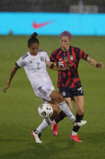Team Mexico defender Bianca Sierra (2) holds off a challenge from USWNT midfielder Megan Rapinoe (15) in the first of two 2021 WNT Send-Off Series games between the USWNT and Mexico at Rentschler Field in East Hartford, CT on July 1, 2021.