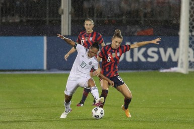 Team Mexico forward Stephany Mayor (10) and USWNT midfielder Kristie Mewis (6) battle for possession in the first of two 2021 WNT Send-Off Series games between the USWNT and Mexico at Rentschler Field in East Hartford, CT on July 1, 2021.
