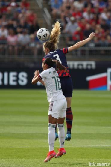 USWNT midfielder Samantha Mewis (3) rises above Team Mexico midfielder Nancy Antonio (16) to head the ball in the second of two 2021 WNT Send-Off Series games between the USWNT and Mexico at Rentschler Field in East Hartford, CT on July 5, 2021.