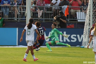 Team Mexico goalkeeper Itzel Gonzalez (12) comes out to block USWNT forward Alex Morgan (13) from getting to the goal in the second of two 2021 WNT Send-Off Series games between the USWNT and Mexico at Rentschler Field in East Hartford, CT on July 5, 2021.