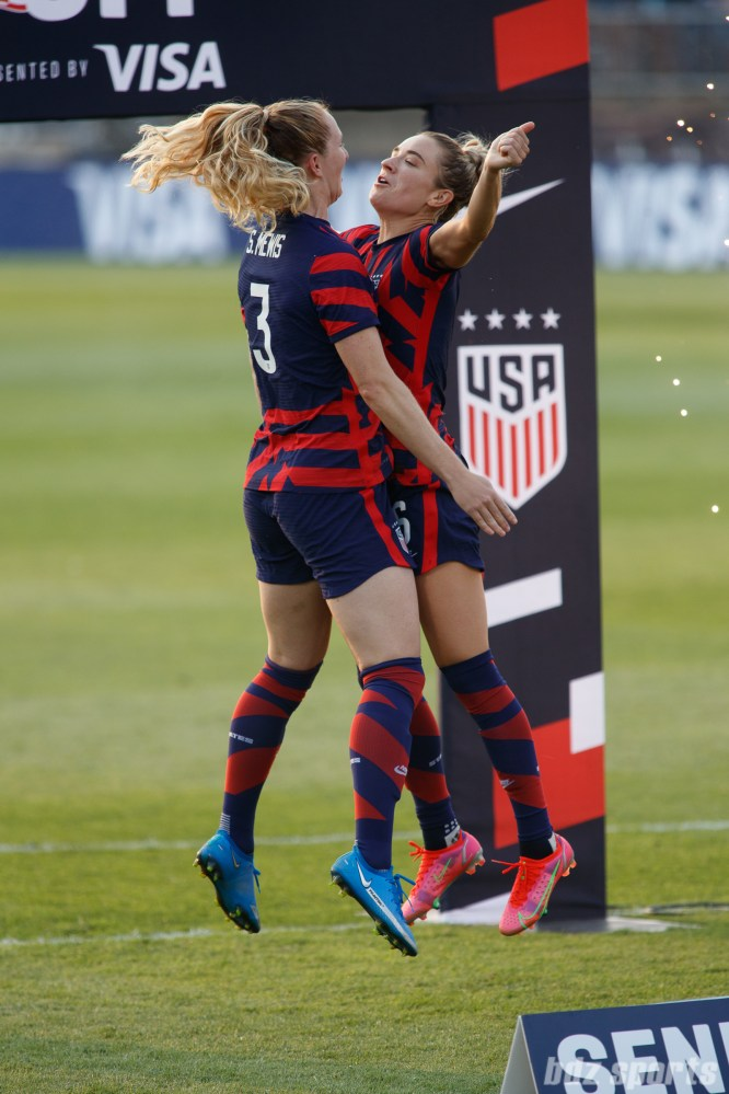 USWNT sisters Samantha (3) and Kristie Mewis (6) chest bump at the end of the final 2021 WNT Send-Off Series game between the USWNT and Mexico at Rentschler Field in East Hartford, CT on July 5, 2021.
