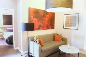 Adina Apartment Hotel,grey couch, orange painting, berlin, checkpoint charlie