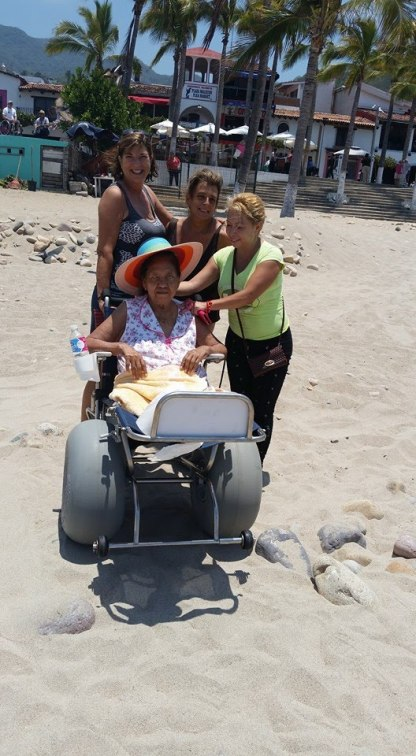 Helping with a beach wheelchair.