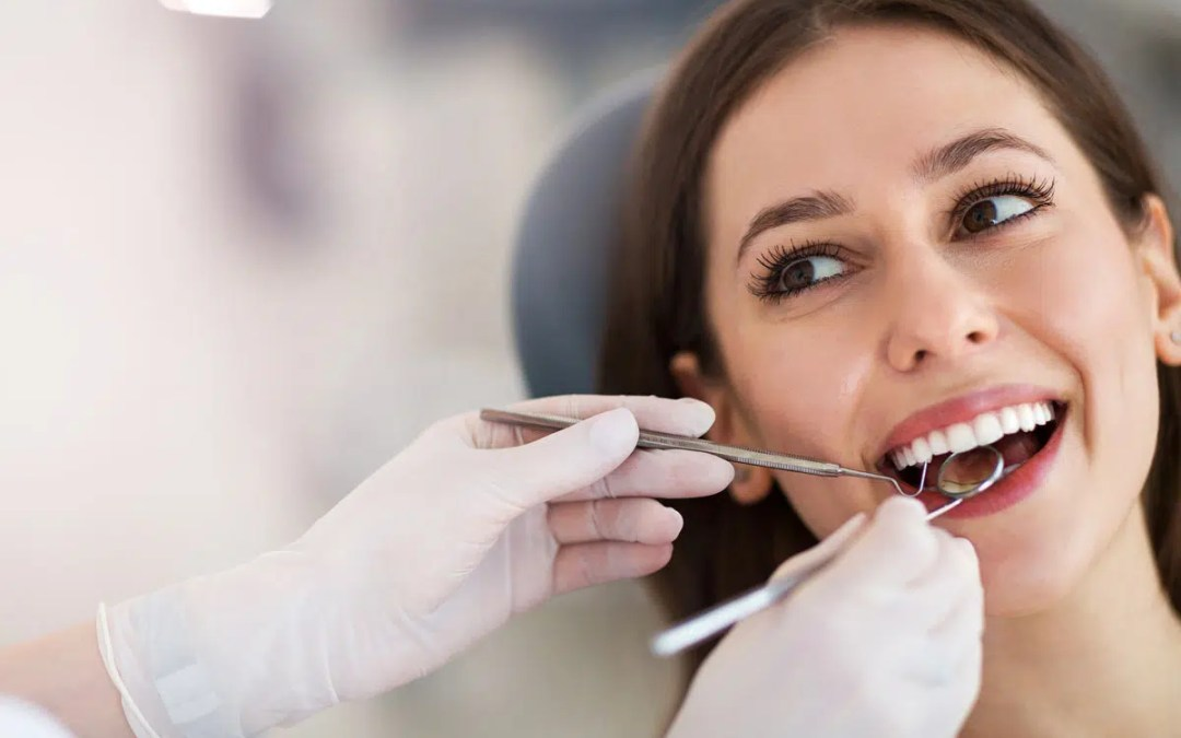 a woman looking at her dentist