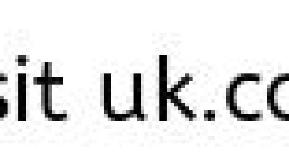 Couple back to back with chalk drawing of a broken heart on a blackboard