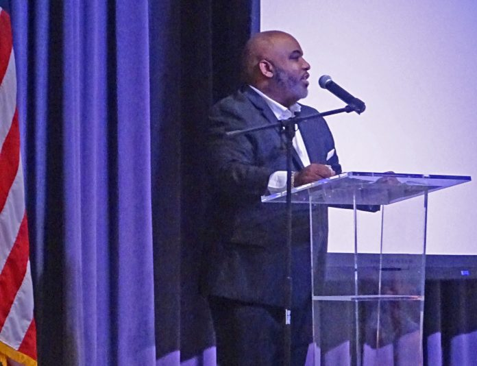 Assistant Deltona City Manager — now interim city manager — Dr. Marc-Antonie Cooper speaks at the city's Dr. Martin Luther King, Jr. memorial breakfast.