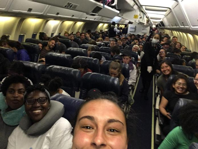 A plane loaded with Peace Corps volunteers, all of whom were suddenly evacuated from positions across Guatemala.