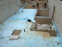 House lower level insulation below floor