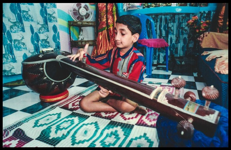 Sai Kaustuv Dasgupta in his Childhood Playing Sitar