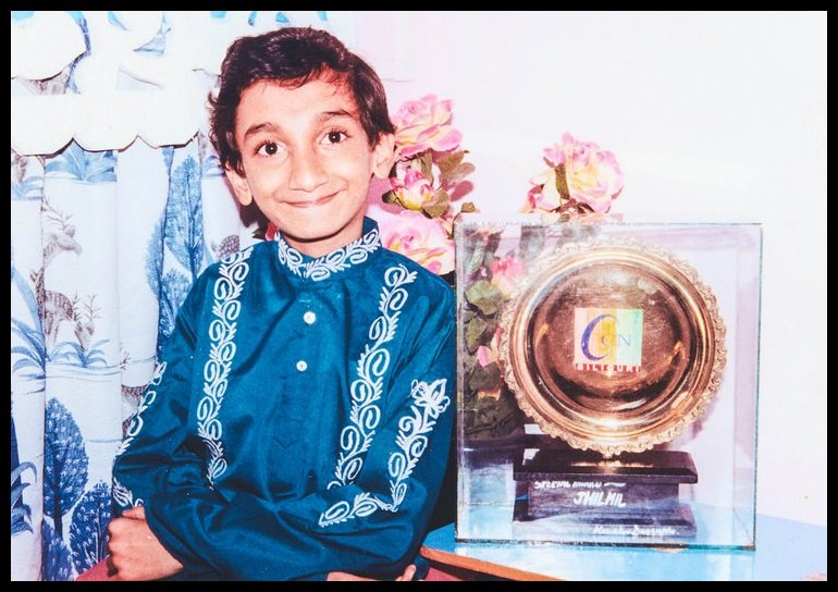 Sai Kaustuv Dasgupta in his Childhood with an Award