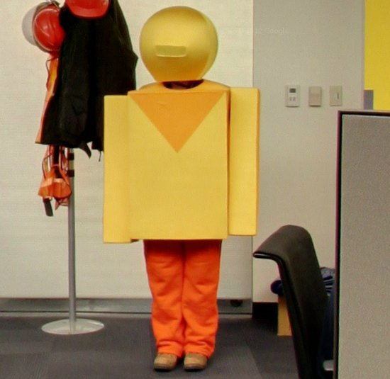A Google employee dressed as an android inside a Google Data Center.