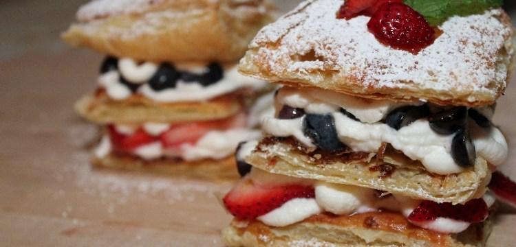 "This Patriotic Berry ""Napoleon"" piles juicy seasonal berries and fluffy sweet cream onto golden puff pastry for a fabulous summer dessert! | dessert recipes | summer recipes | BearandBugEats.com"