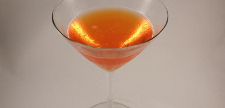 orange-pink Comtesee d'Italia cocktail on white background