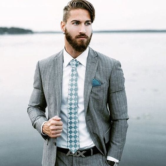 man with beards wearing grey suit