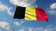 stock-footage-belgian-flag-waving-against-time-lapse-clouds-background