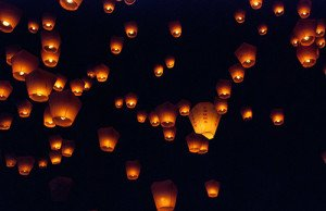 Sky lanterns in night sky