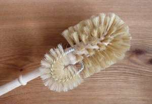 Wooden toilet brush with edge cleaner and tampico bristles