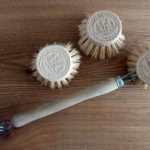 Wooden washing up brush with replaceable heads