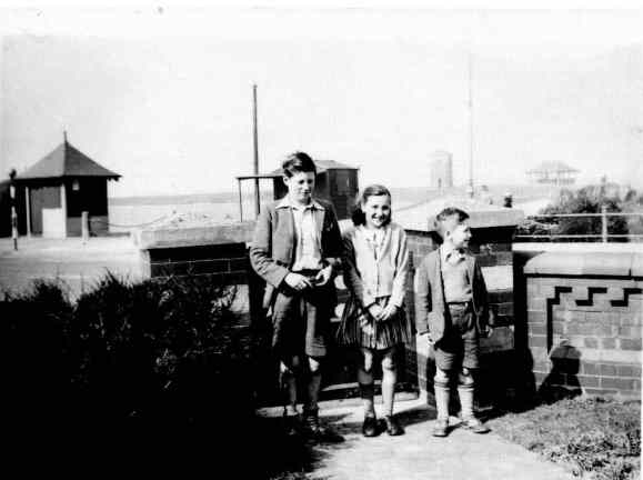John Lennon with cousins Leila and Stanley Parkes, 1940s