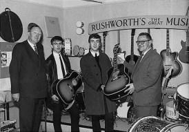 John Lennon and George Harrison receive Gibson J-160E guitars, Rushworth's Music House, Liverpool, September 1962
