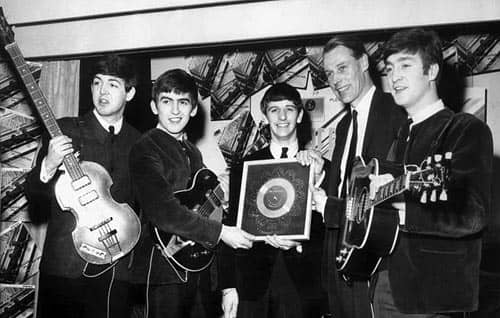 The Beatles receive their first silver disc. With George Martin, 5 April 1963