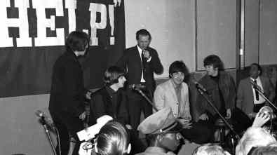 The Beatles with press officer Tony Barrow, 1965