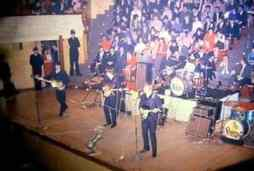 The Beatles on stage in Dunedin, New Zealand, 26 June 1964
