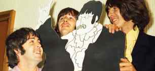 Paul McCartney, George Harrison and Ringo Starr with a John Lennon cardboard cutout