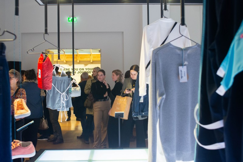 The main room downstairs in the Fashion for Good Museum displays a collection of sustainable clothes.