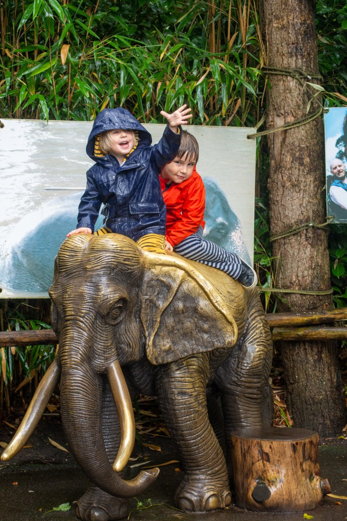 Kids on top of elephant sculpture at DierenPark Amersfoort by Beatrice Murch