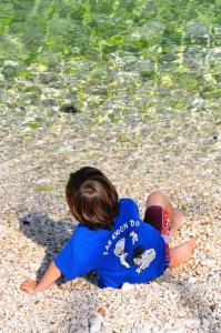 boy playing in limpid sea