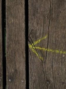 Chalk arrow on wood