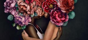 Black woman and white man hugging