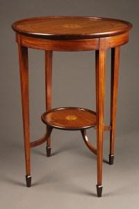 Round antique mahogany lamp table.
