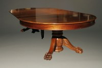 Antique pedestal table with leaves.