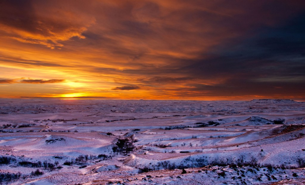 From Square Butte, a winter sunset showing sentinel butte on the horizon.