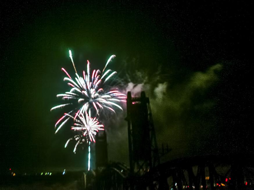 Fireworks illuminate the Fairview Lift Bridge