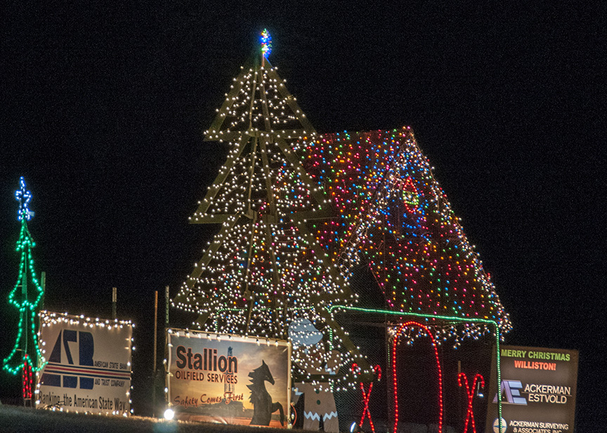 Area businesses work together to put together each of the displays at the Williston drive through Christmas Lights display.