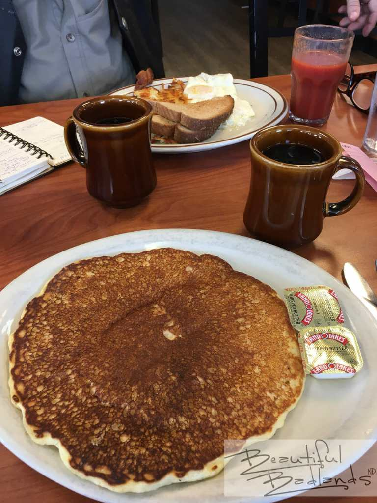 When the pancakes are as big as the plate and the eggs and sausage fill a dinner plate, we dig in and eat!