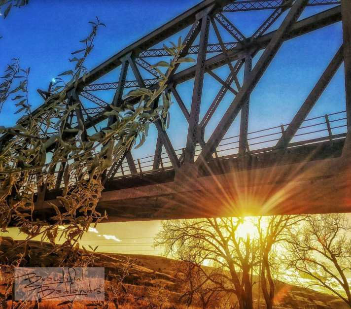 As the sun lowers in the west the light warms, and the montrous iron railroad bridge in north eastern Montana, which some believe to be haunted, becomes nearly inviting in a mezmerizing sort of way.
