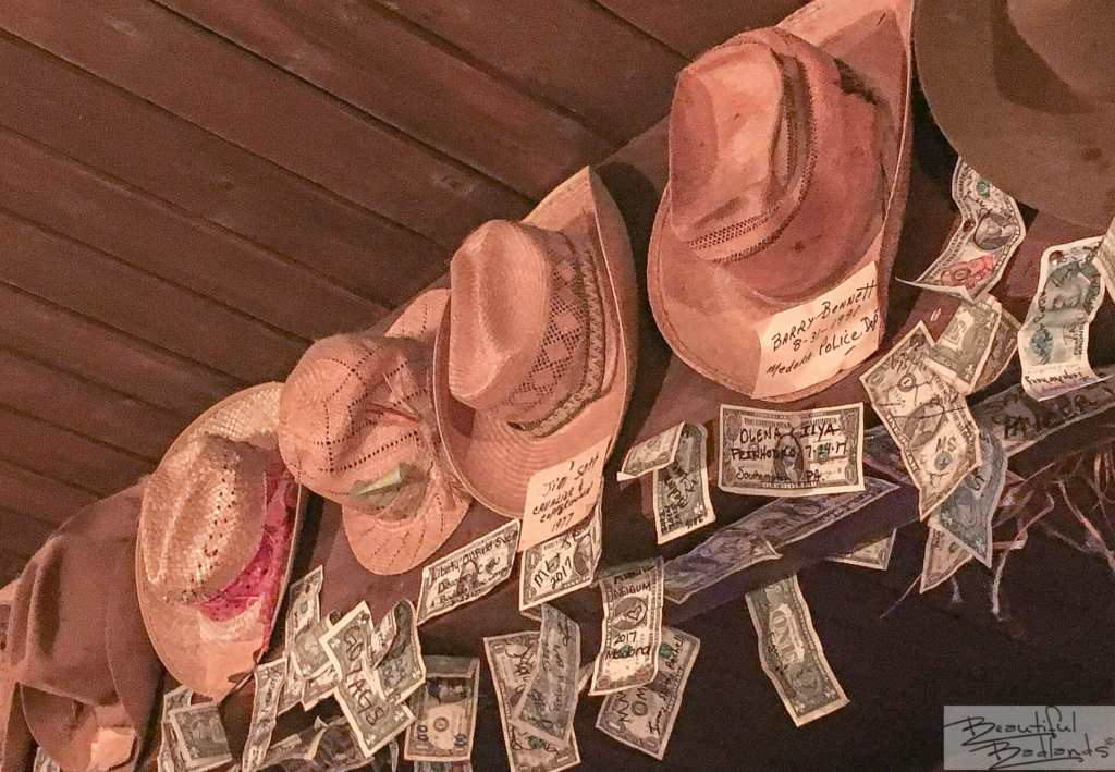 A Row of Special Patrons, Hats and Dollar Bills Line the Rafters!