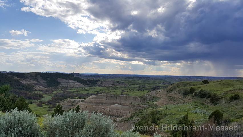 Rain Approaching the Lush Green Badlands of North Dakota, by Brenda Hildebrant-Messer
