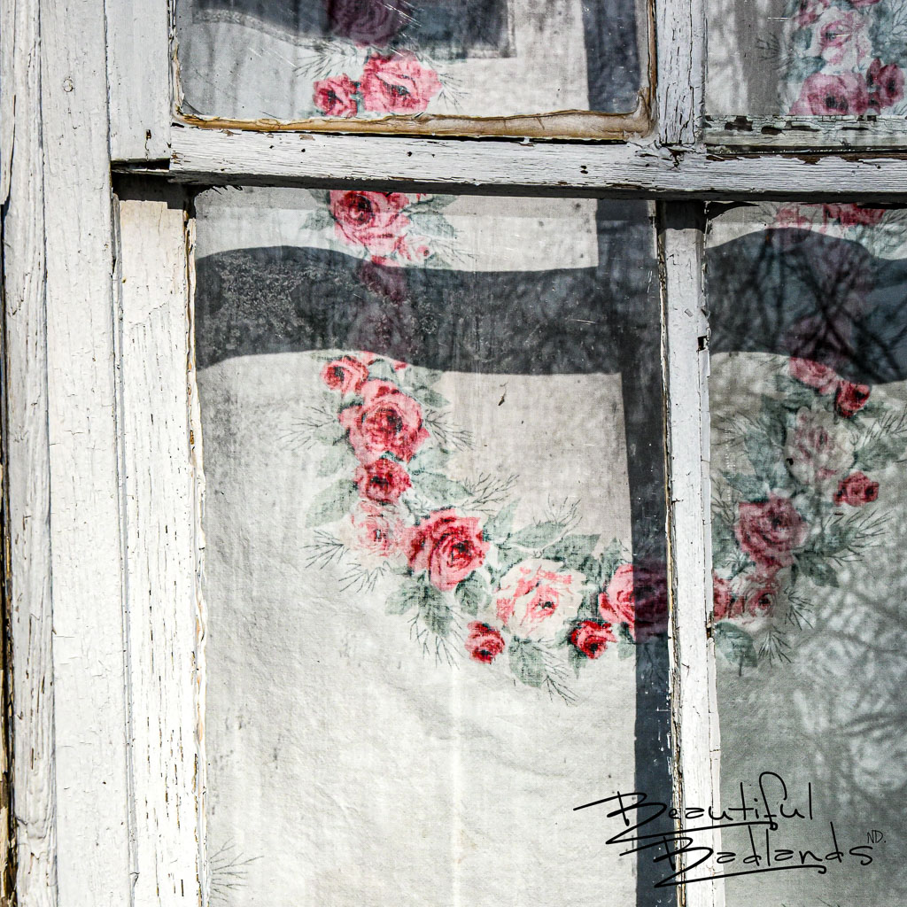 The sight of weathered cotton, floral printed curtains in the old Grassy Butte Post Office Museum in Grassy Butte, North Dakota, conjure up nostalgic memories, warm feelings of years gone by. More here: https://wp.me/p8zmWn-3Hb https://wp.me/p8zmWn-3E8