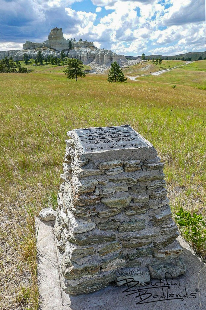 This metal plaque on a stone structure commemorates the 1979 designation of Capitol Rock as a National Natural Landmark. July 14, 2020