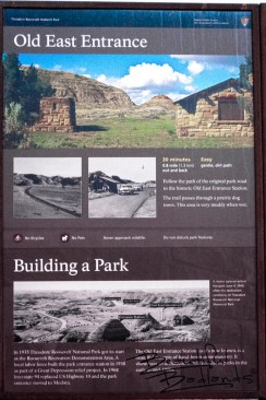The Old East Entrance Trailhead sign at the South Unit of Theodore Roosevelt National Park displays information about the entrance which served Old Highway 10. The park was dedicated as Theodore Roosevelt National Memorial Park June 4, 1949.