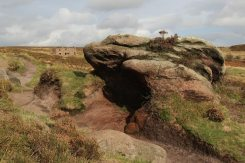 Gritstone boulder and abandoned farmhouse, The Roaches, Staffordshire Moorlands