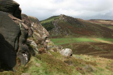 Gritstone boulders and The Roaches, from Hen Cloud