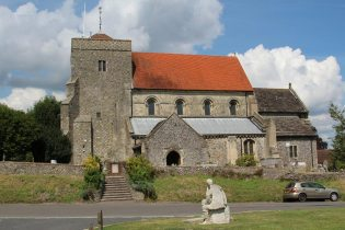 Statue of Saint Cuthman and St. Andrew's Church, Steyning